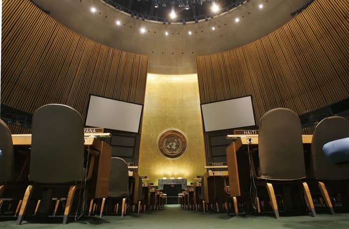 The United Nations logo on the back wall of the General Assembly Hall of the United Nations is seen from the floor May 12, 2006 at the United Nations headquarters in New York.