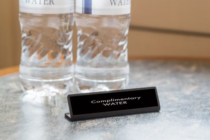 Complimentary water bottle for hotel guest in hotel room