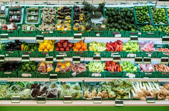 Stand with fruits and vegetables in the supermarket