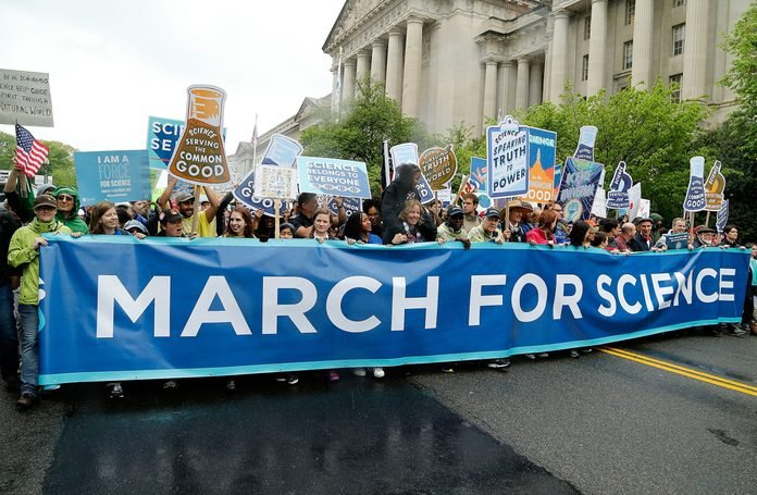 Marchers head down Constitution Avenue toward the U.S. Capital Building during the Earth Day March for Science on April 22, 2017 in Washington, DC.