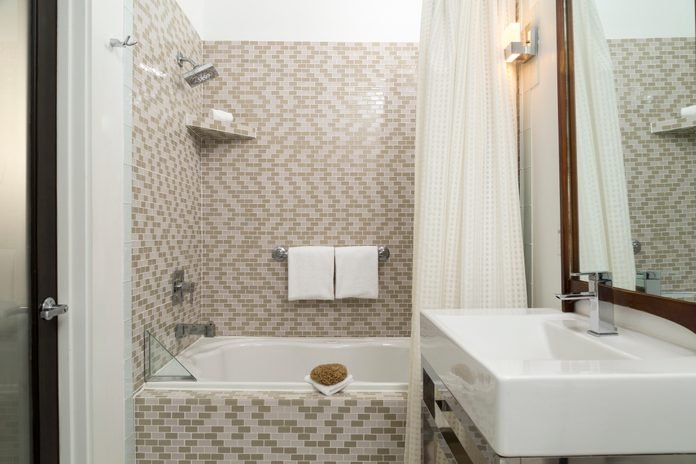 Tiled Bathroom with Shower and Vanity in a Hotel