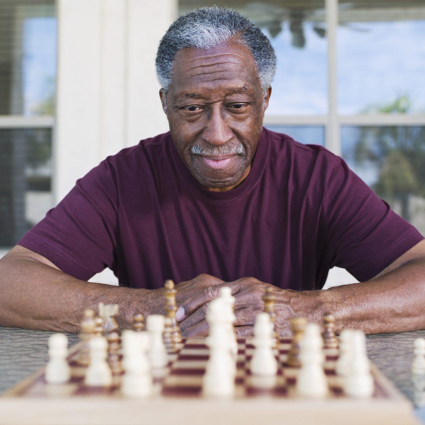 Senior African man playing chess