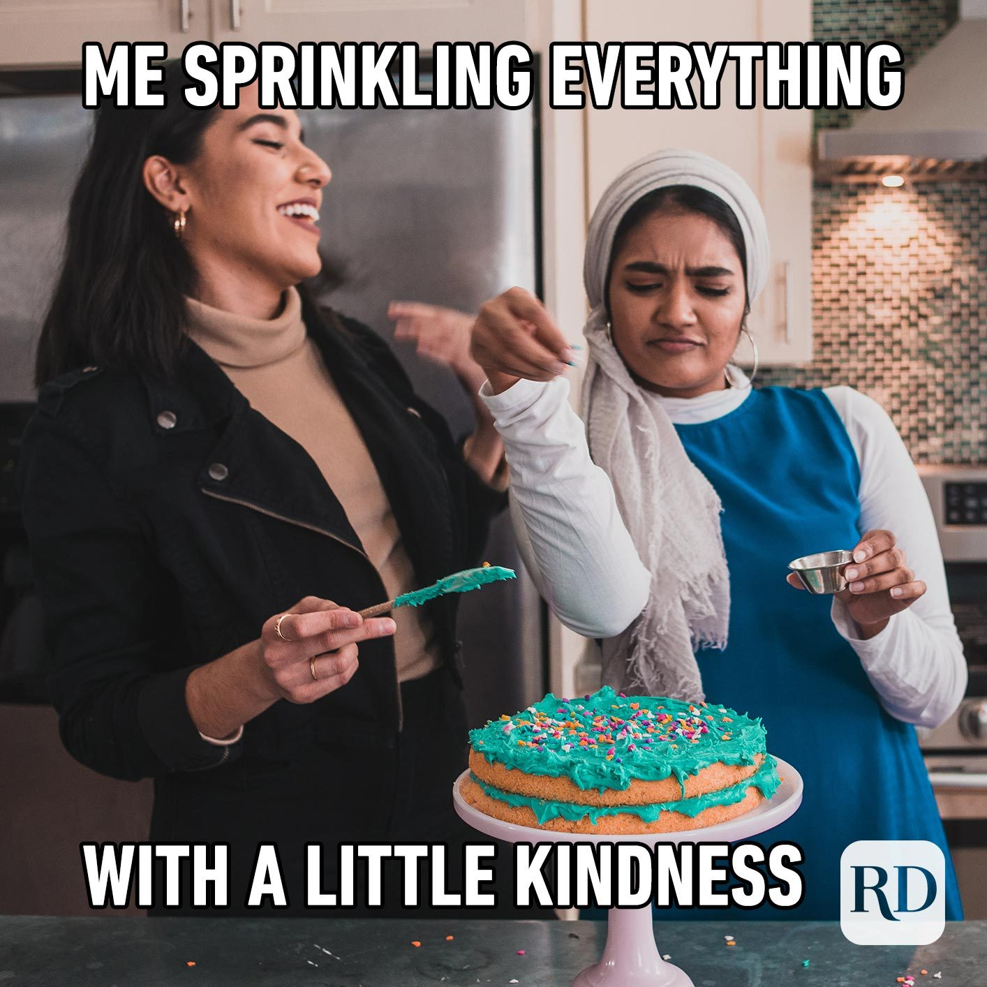 Two women making a cake, dusting it with sprinkles. Meme text: Me sprinkling everything with a little kindness