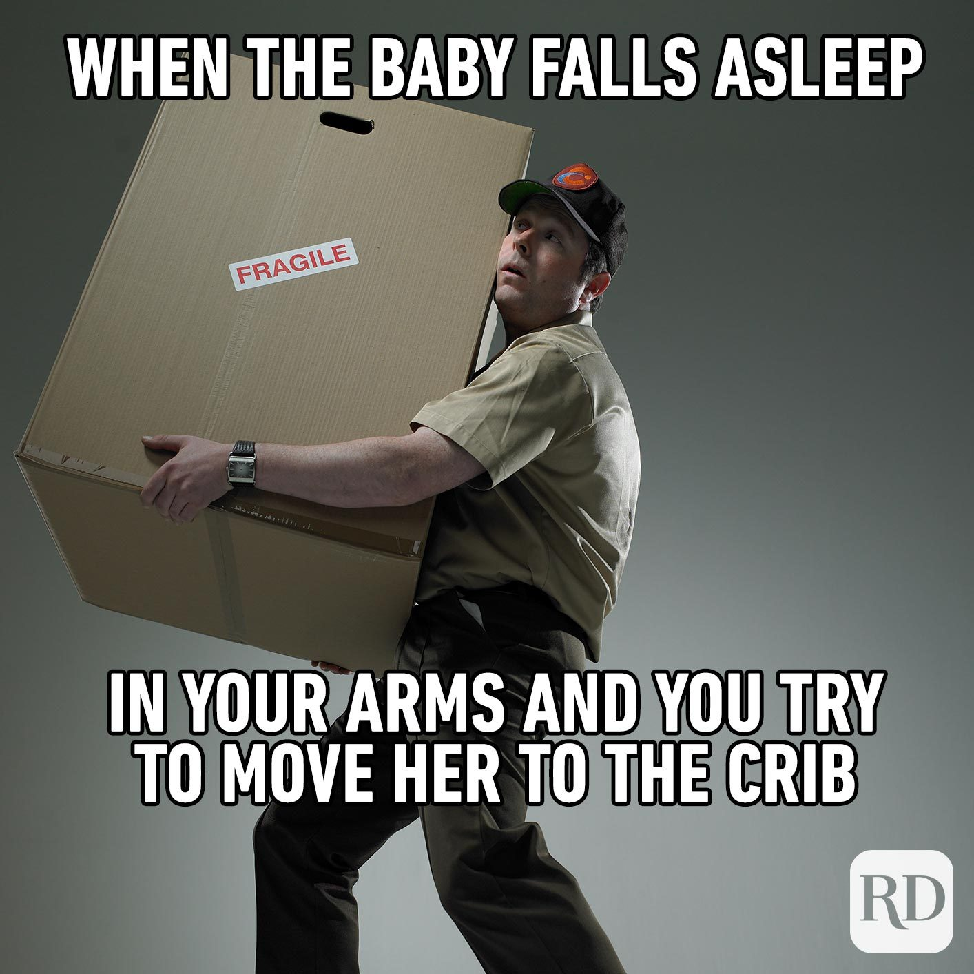 Delivery man holding large package. MEME TEXT: When the baby falls asleep in your arms and you try to move her to the crib