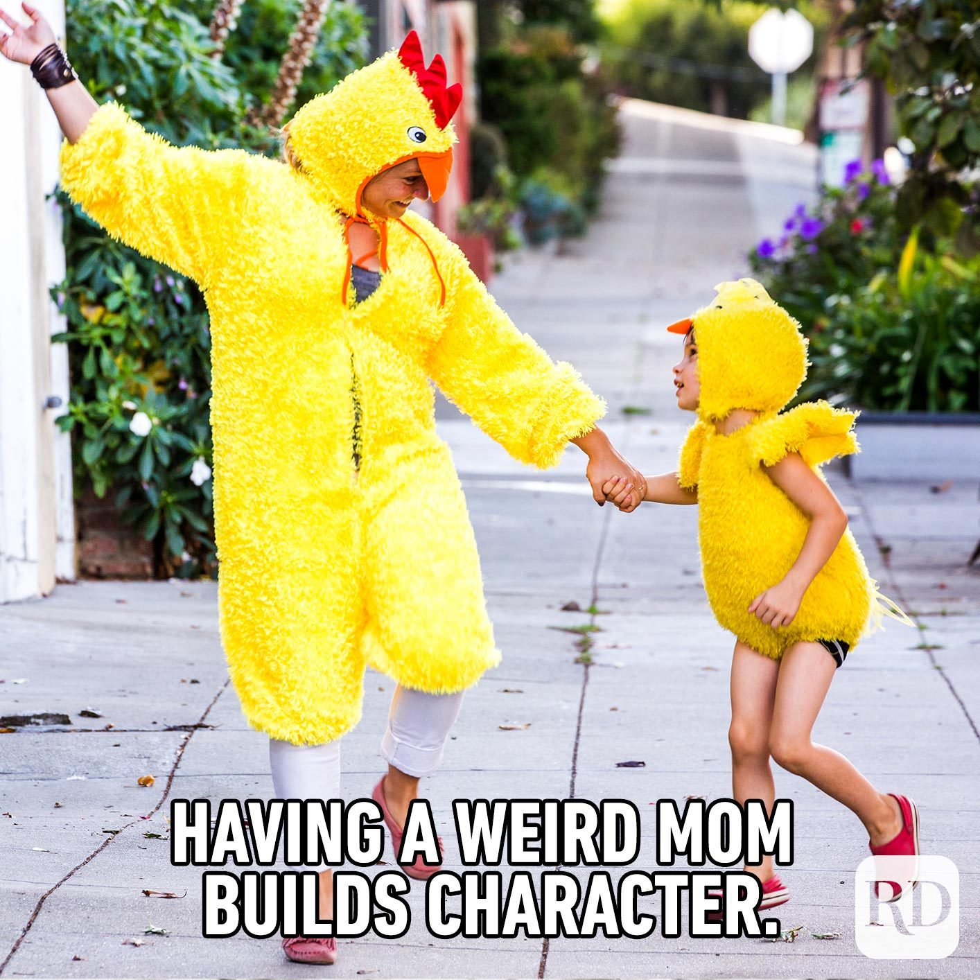 Mom and child in matching chicken costumes. MEME TEXT: Having a weird mom builds character