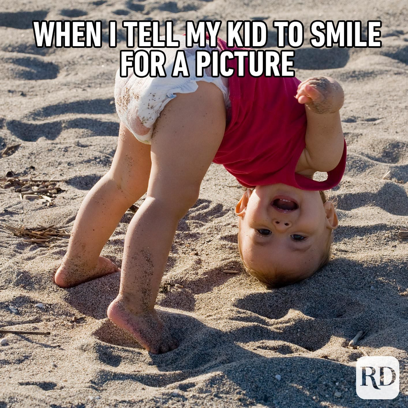 Child upside down laughing. MEME TEXT: When I tell my kid to smile for a picture