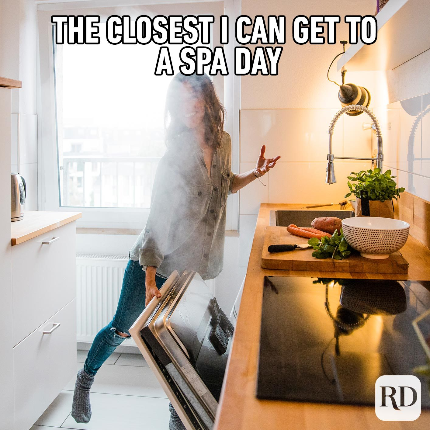 Woman being covered with steam from the dishwasher. MEME TEXT: The closest I can get to a spa day...