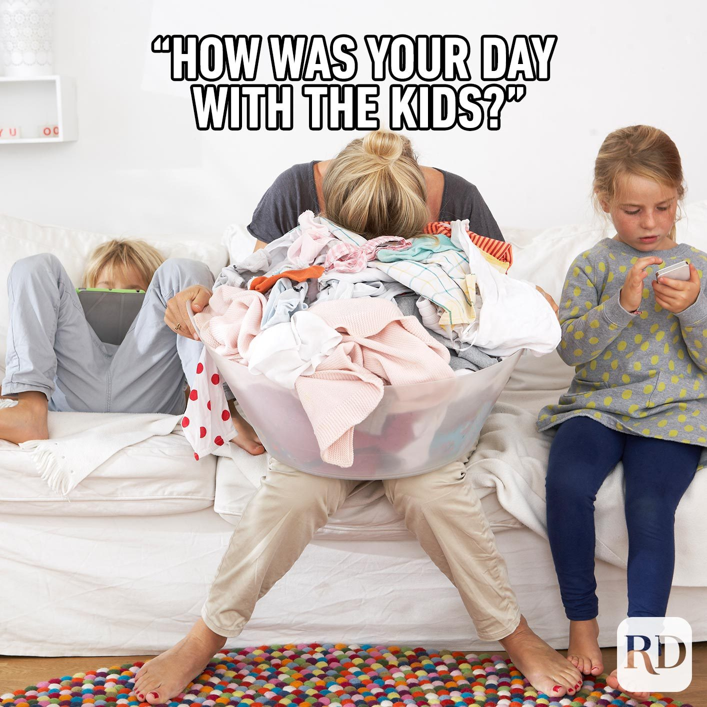 """Woman shoving her face into the laundry. MEME TEXT: """"How was your day with the kids?"""""""
