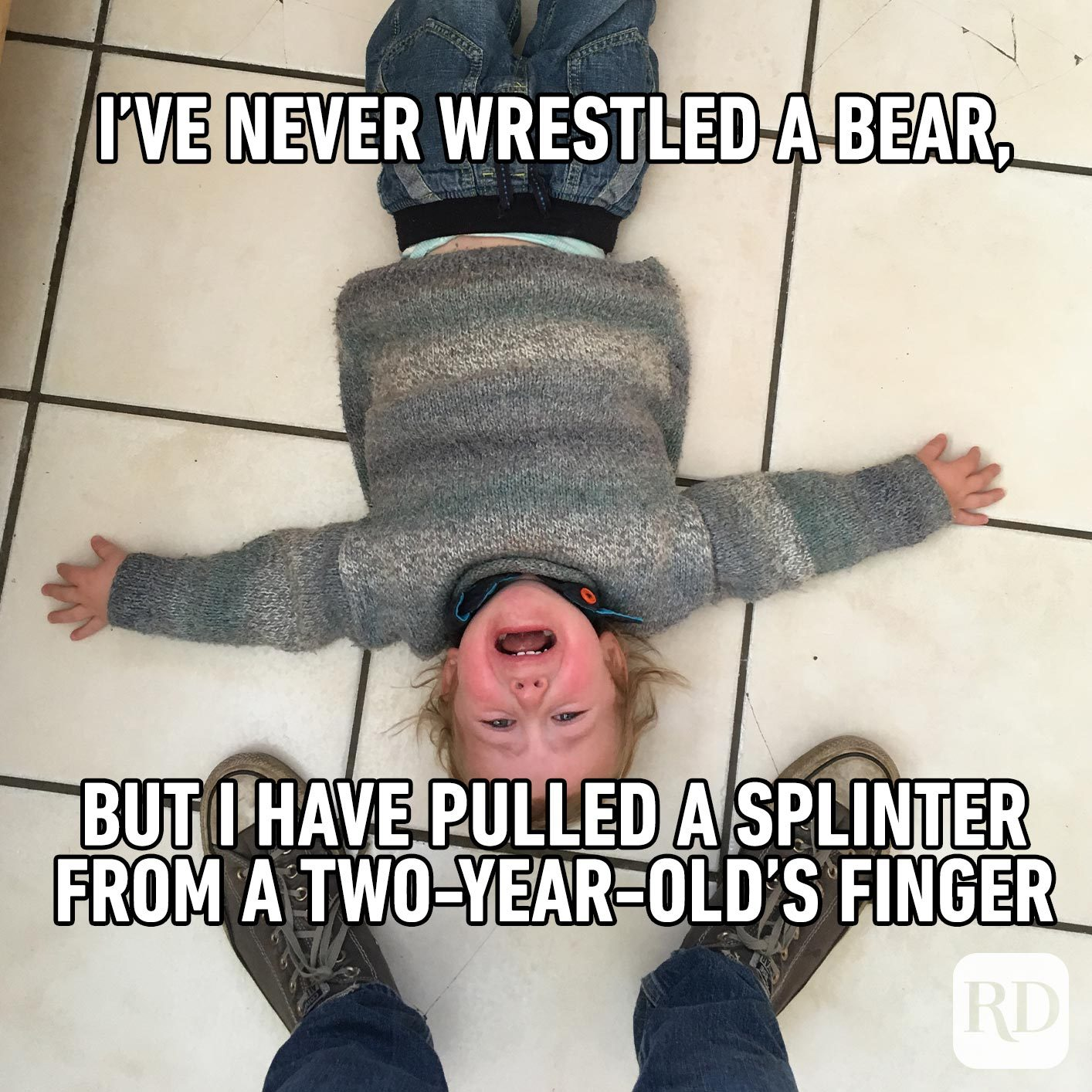 Child throwing tantrum on the floor. MEME TEXT: I've never wrestled a bear, but I have pulled a splinter from a two-year-old's finger