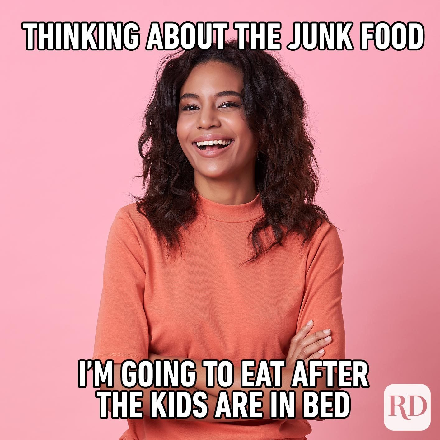 Woman with arms crossed, smiling. MEME TEXT: Thinking about the junk food I'm going to eat after the kids are in bed