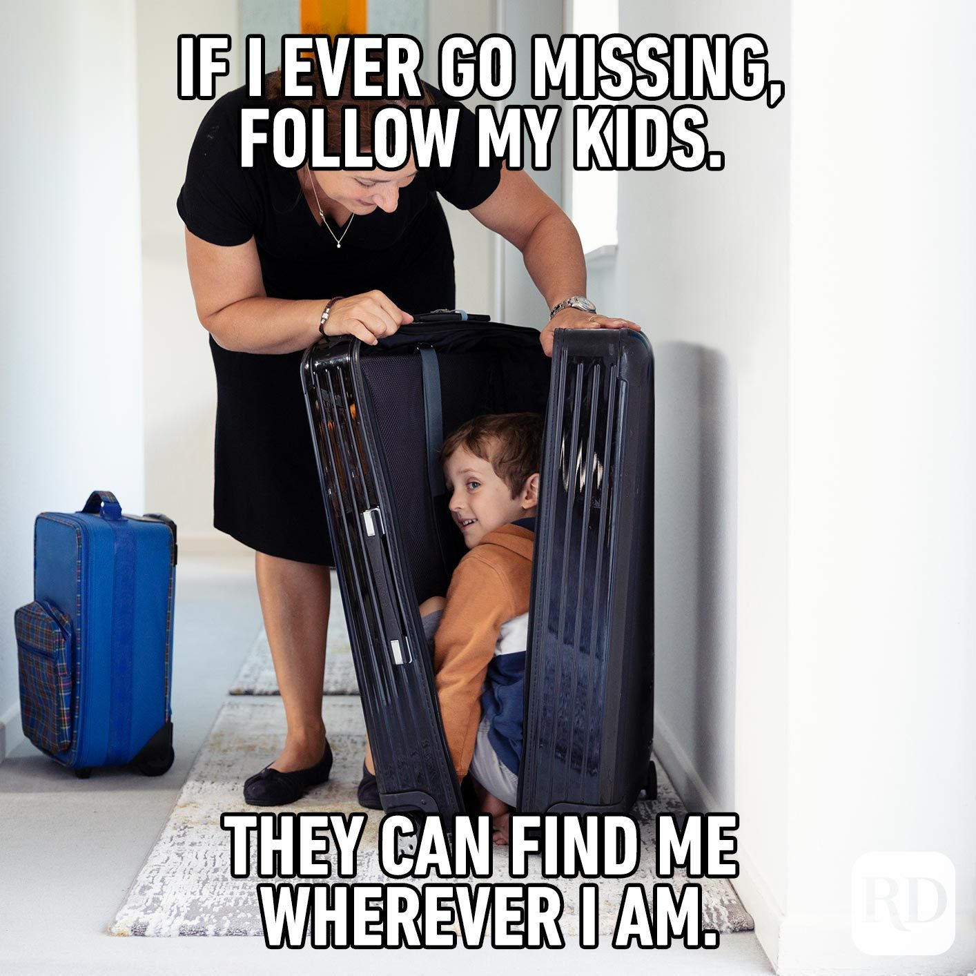 A mother finding her child hiding in a suitcase. MEME TEXT: If I ever go missing, follow my kids. They can find me wherever I am.