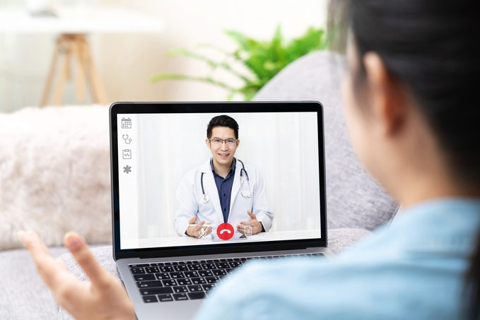 Asian chinese doctor video conference call online talking for follow up remotely with medical coronavirus result at home.Online healthcare digital technology service, counselor and interview app.
