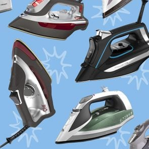 Collection of steam irons on a blue background