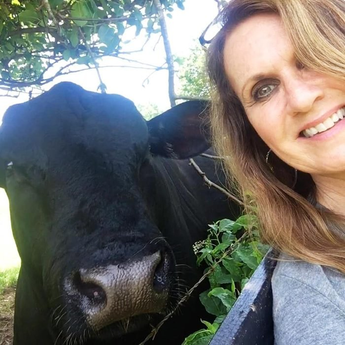 Buster, the cow, and the woman take a selfie