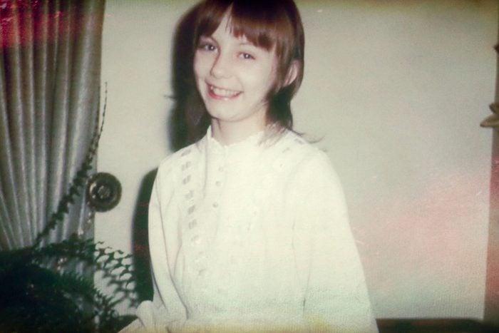 little girl smiling in vintage photo