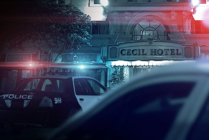 Police cars with lights flashing in front of Cecil Hotel