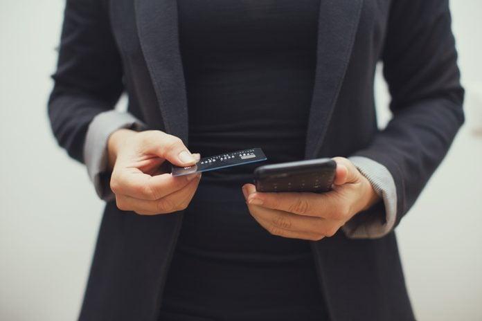 Woman wearing Blazer ordering something online