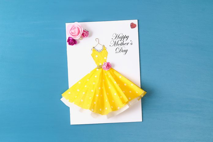 Diy Mothers Day greeting card with a paper napkin dress and flower decoration.