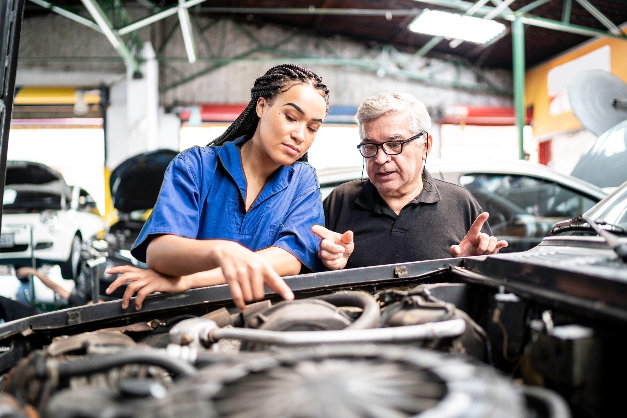 mechanic explaining repair to customer