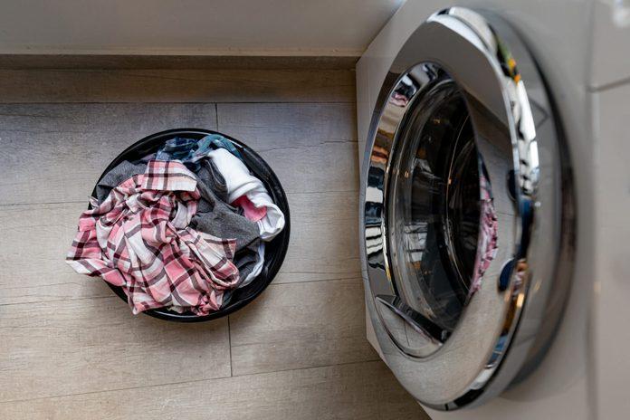Laundry basket next to the washing machine
