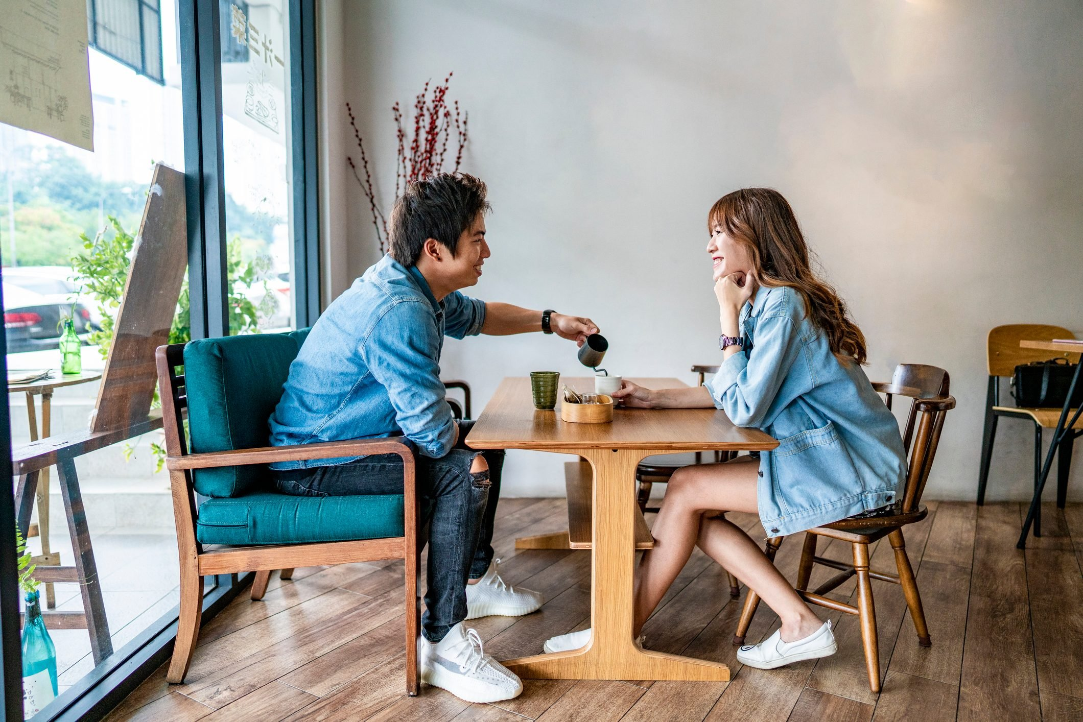 Young Asian couple drinking coffee at cafe coffee shop