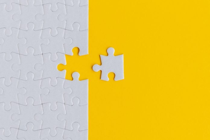 Jigsaw Puzzle on Yellow Background