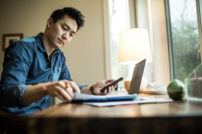 Man working on mobile banking