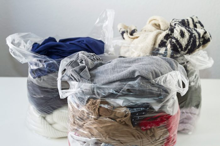 clear plastic bags filled with old clothes