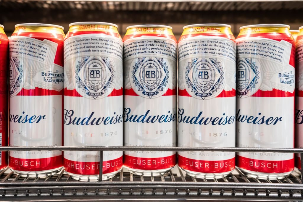 Budweiser beer cans displayed for sale in a supermarket...
