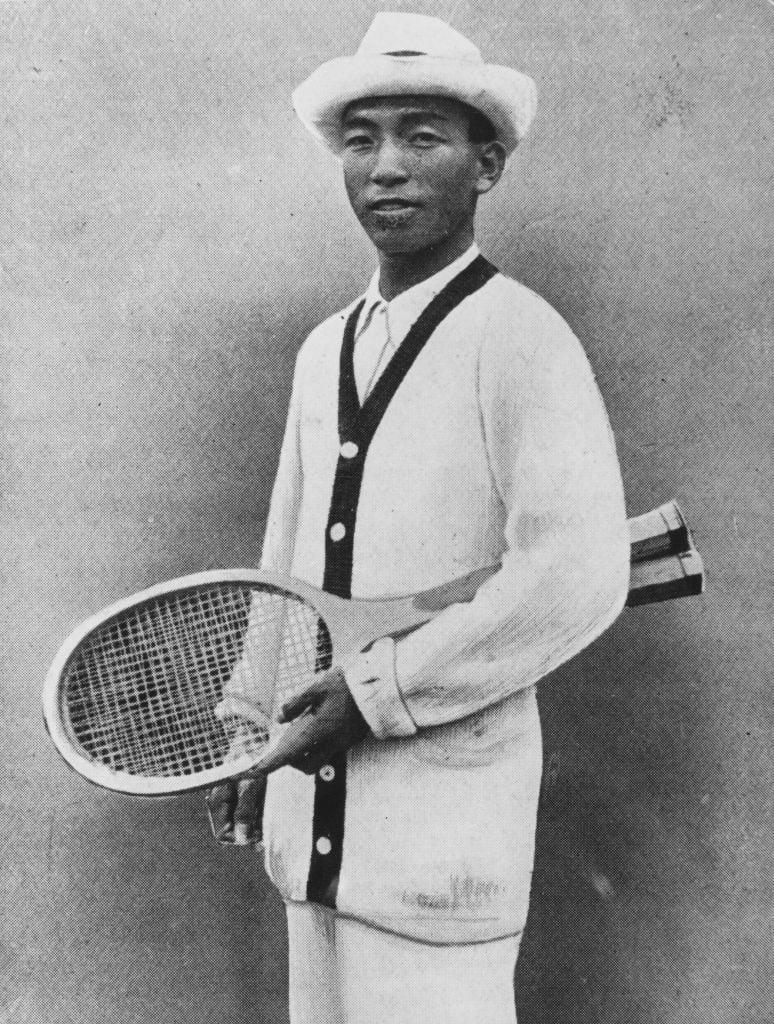 Zenzo Shimizu posing with his tennis racket