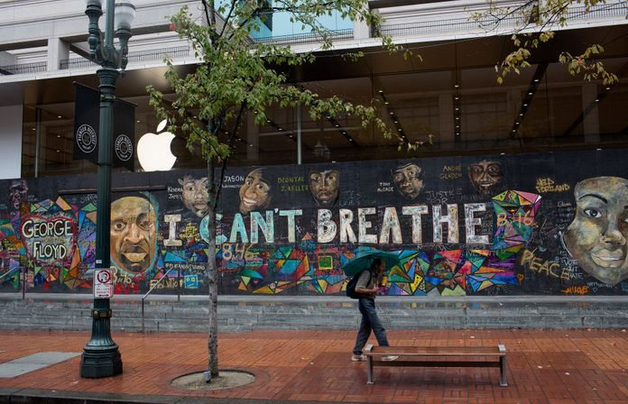 Black Lives Matter graffiti and murals cover many buildings downtown, including national chain stores such as Apple and Louis Vuitton, as seen on September 25, 2020 in Portland Oregon.