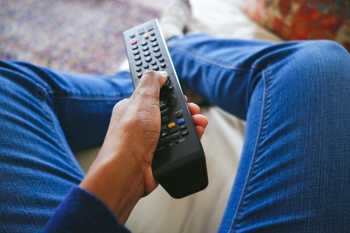 Woman Holds TV Remote Control