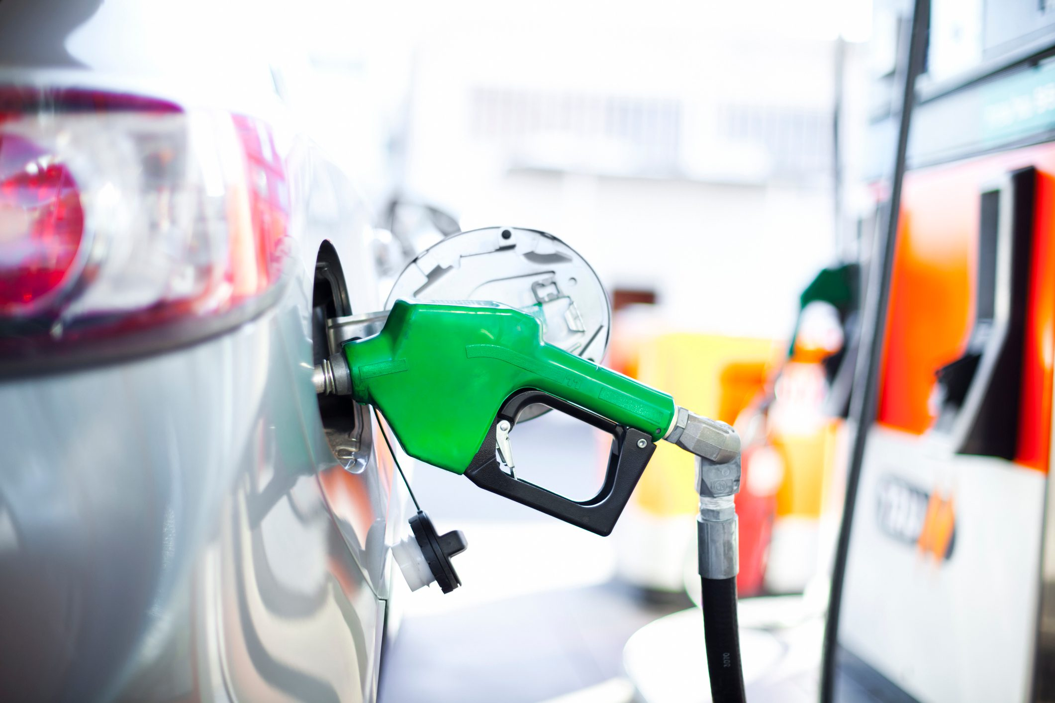 gas pump filling car with fuel