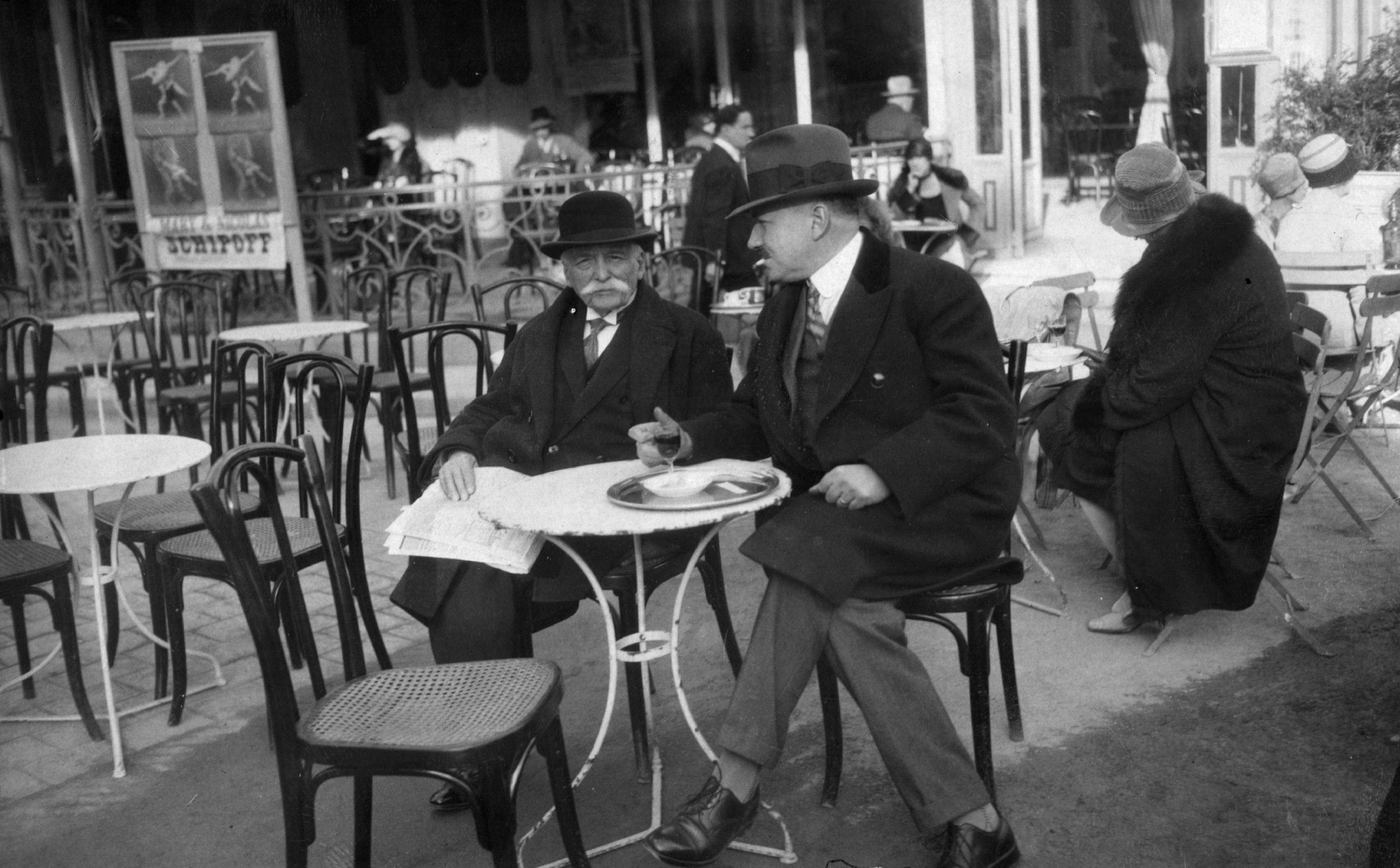 Two men sitting at a Paris Cafe