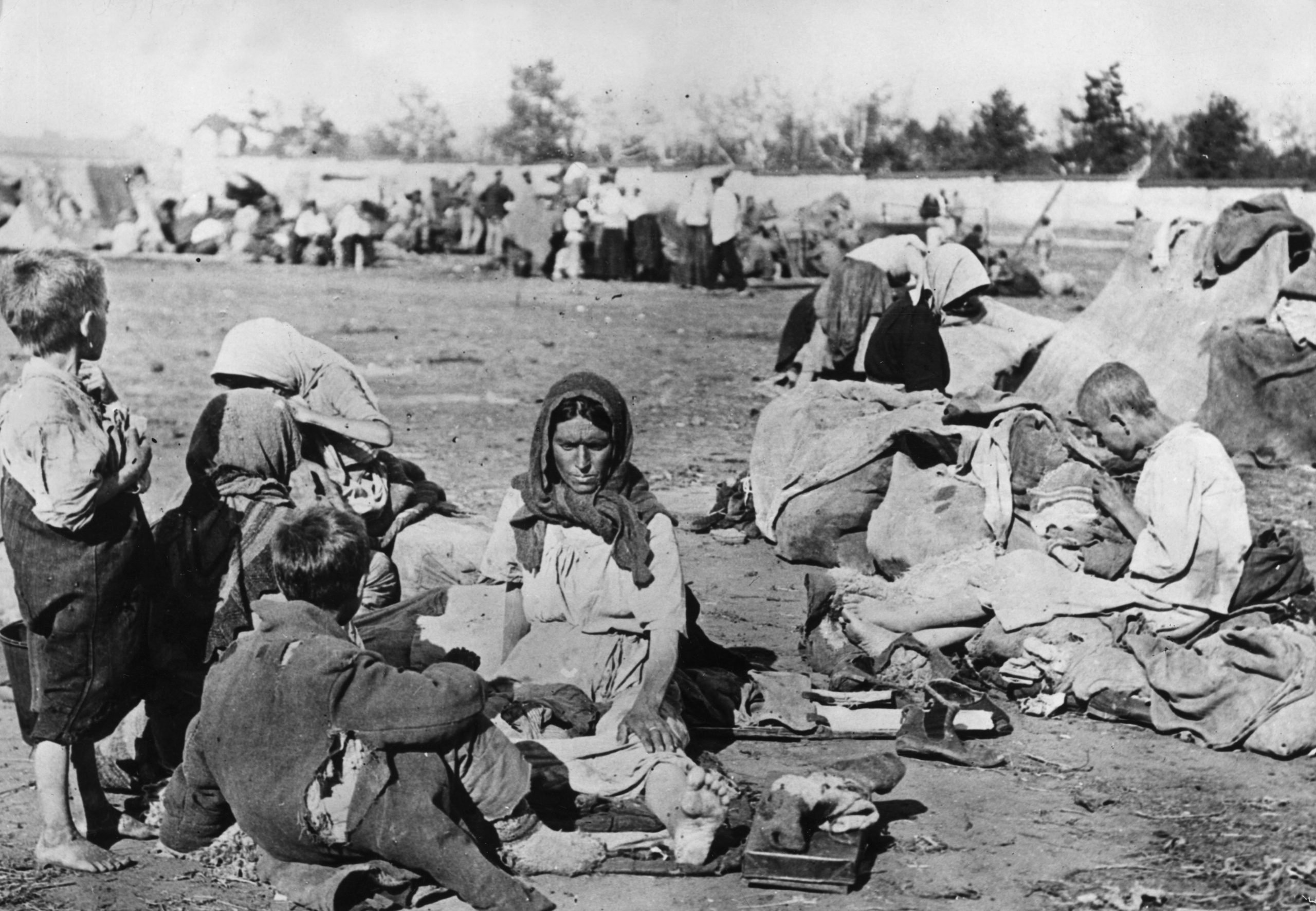 October 1921: Ragged and barefoot, starving Russian families in the Volga area during the Russian Famine.