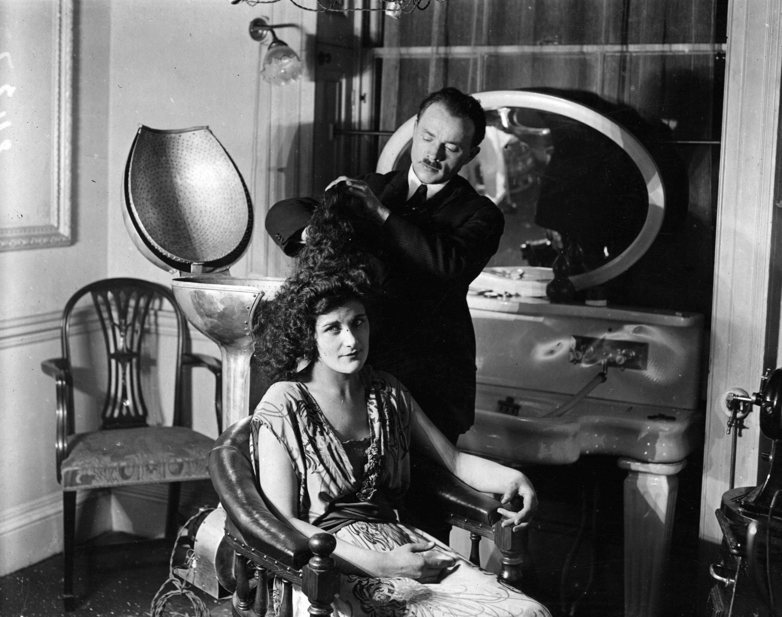 Woman getting hair permed