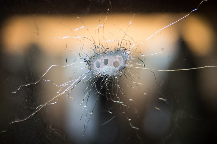 Bullet holes in cracked glass