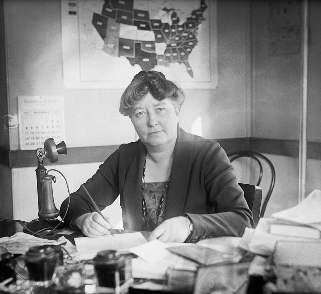 Mary Anderson at Desk