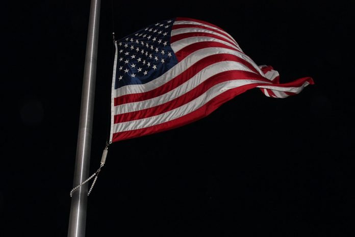 US Flag in the Wind at Night