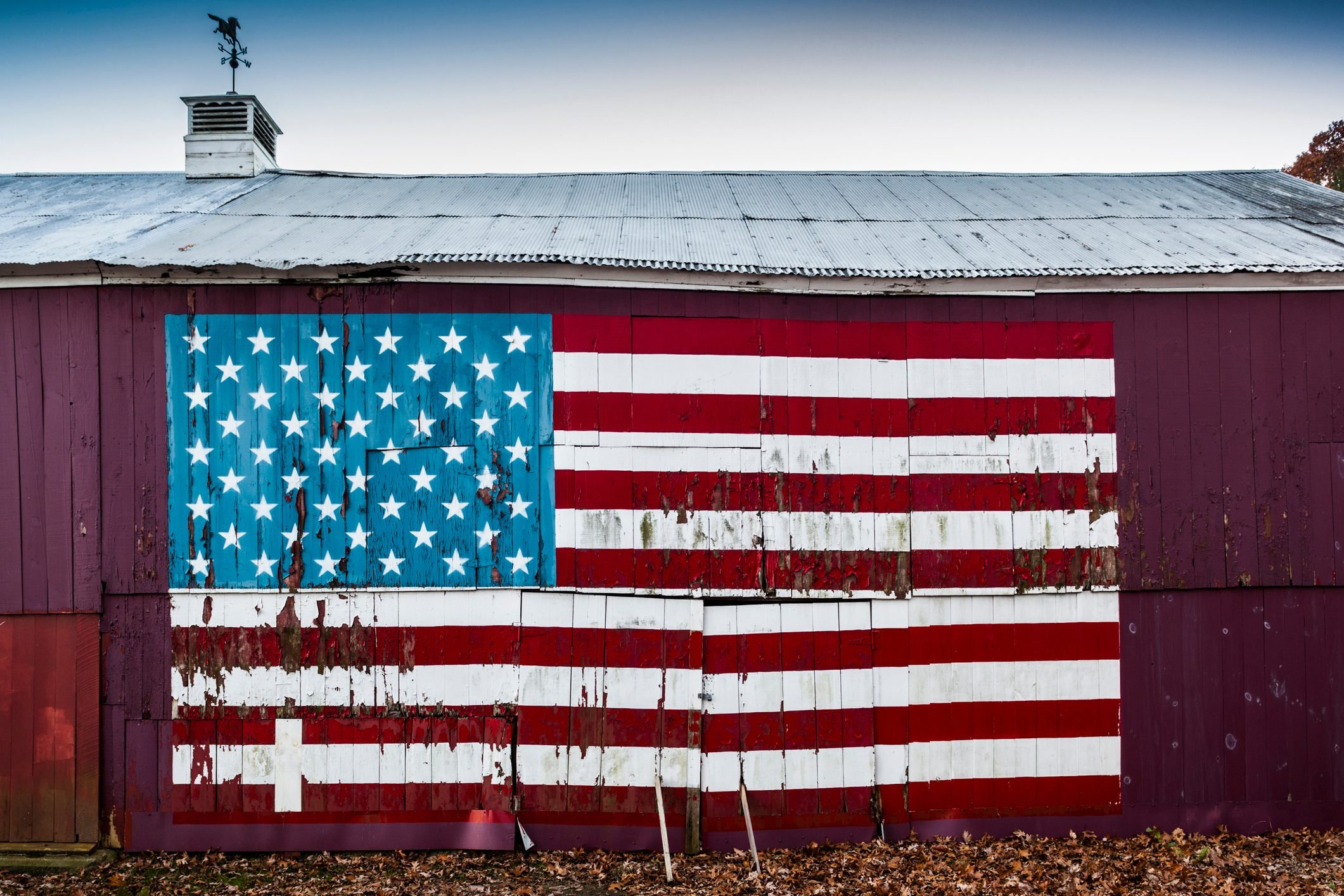 barn exterior with a large painted american flag in quinebaug, connecticut