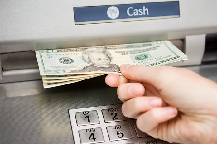 Person withdrawing cash