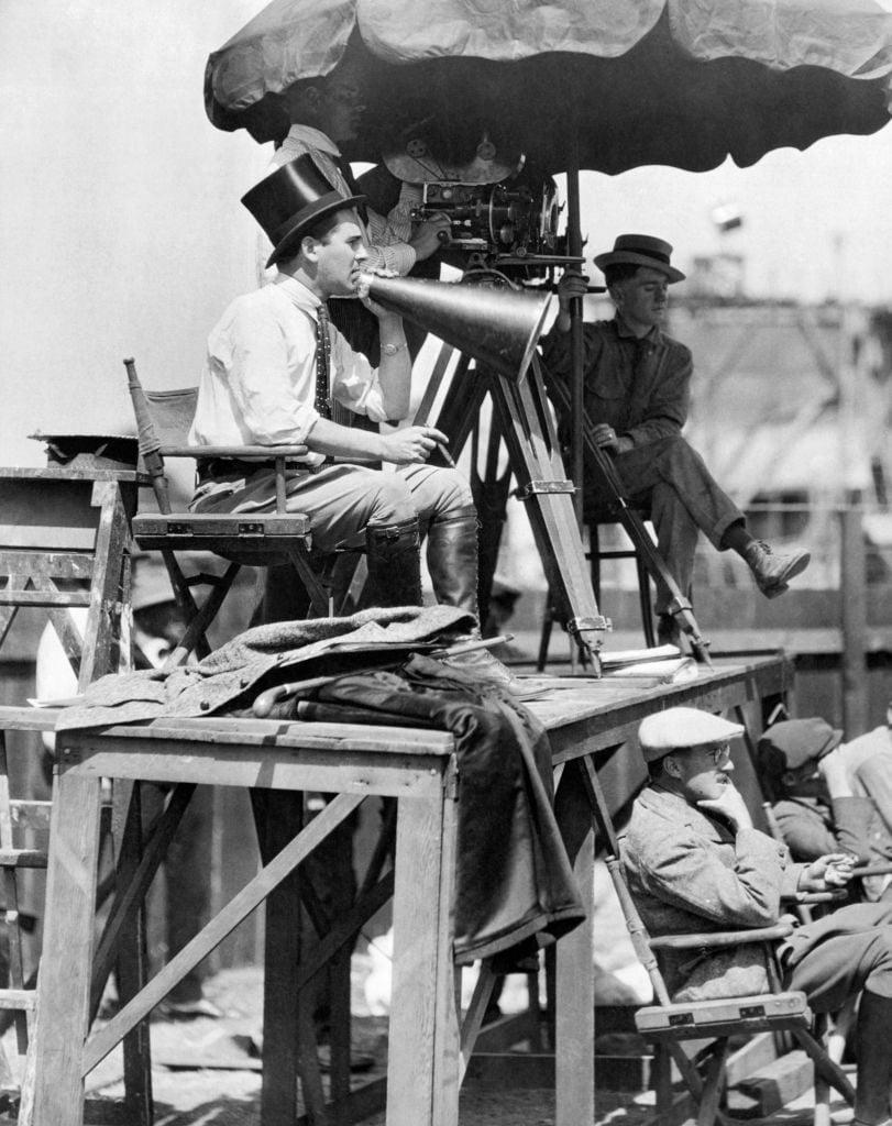 Director Rex Ingram at set with megaphone