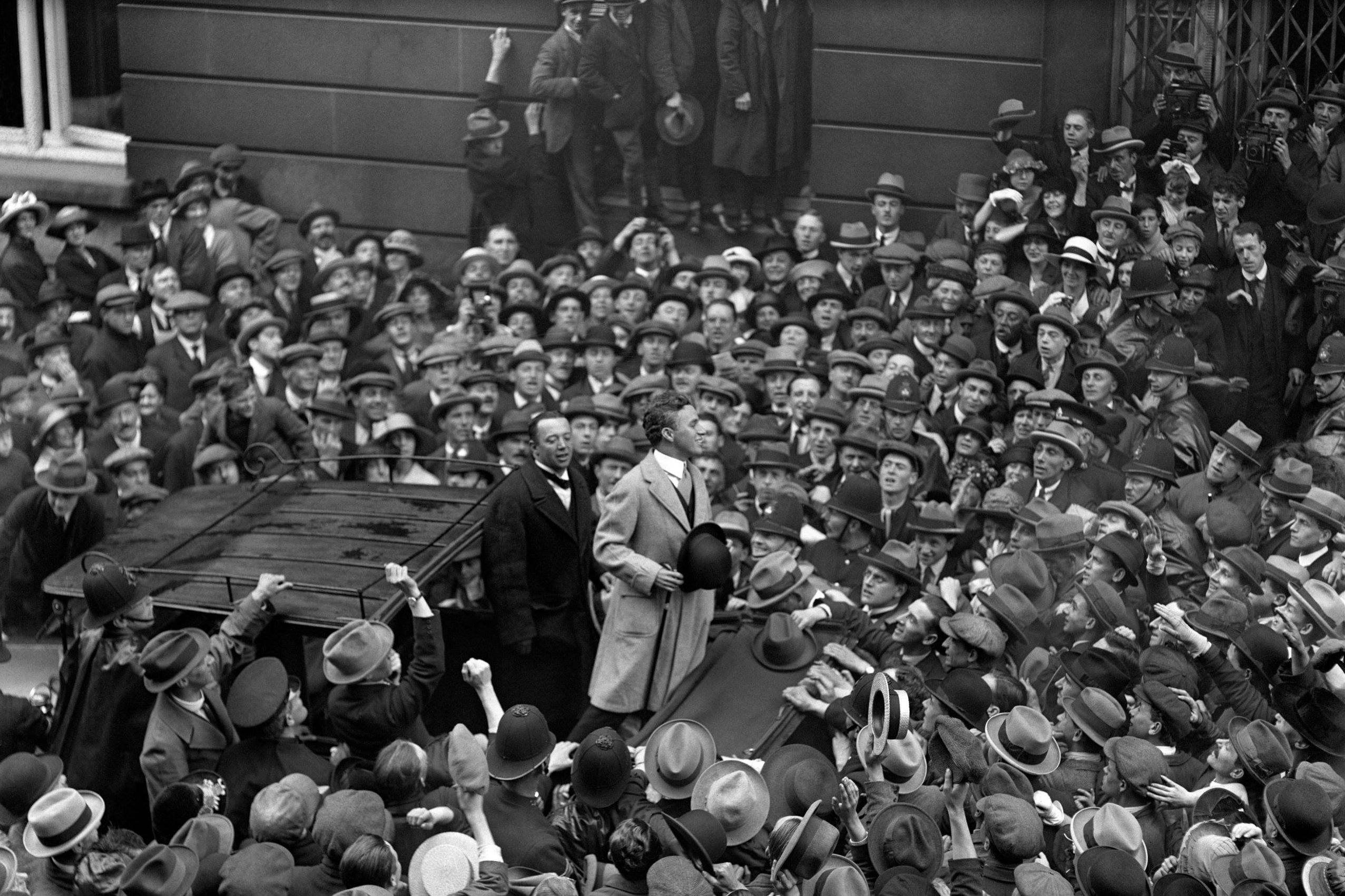 Charlie Chaplin, addressing the crowd outside the Ritz Hote