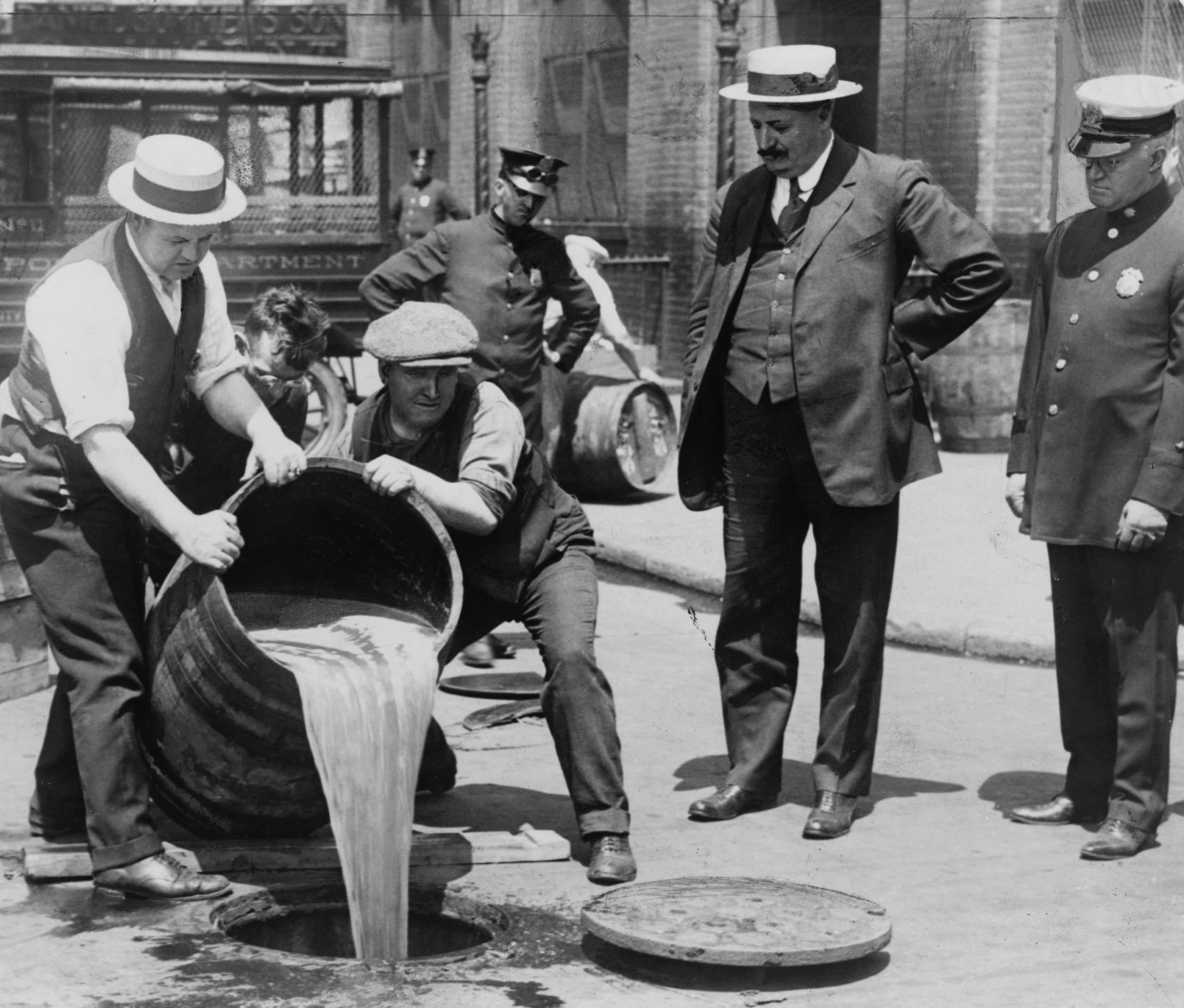 Pouring out illegal alcohol into a Sewer