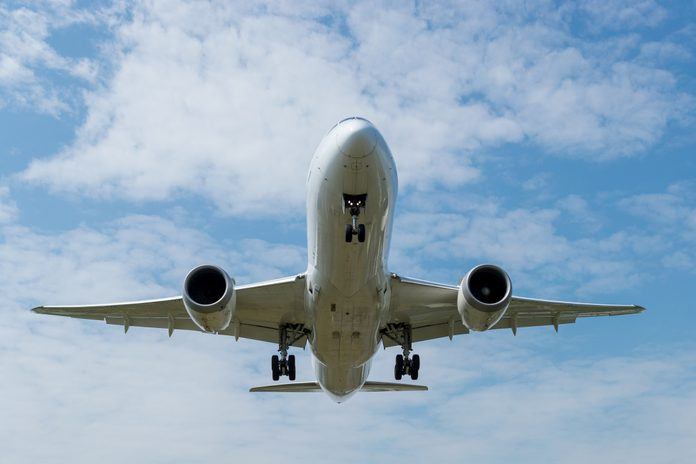 Front view of a Landing airplane.
