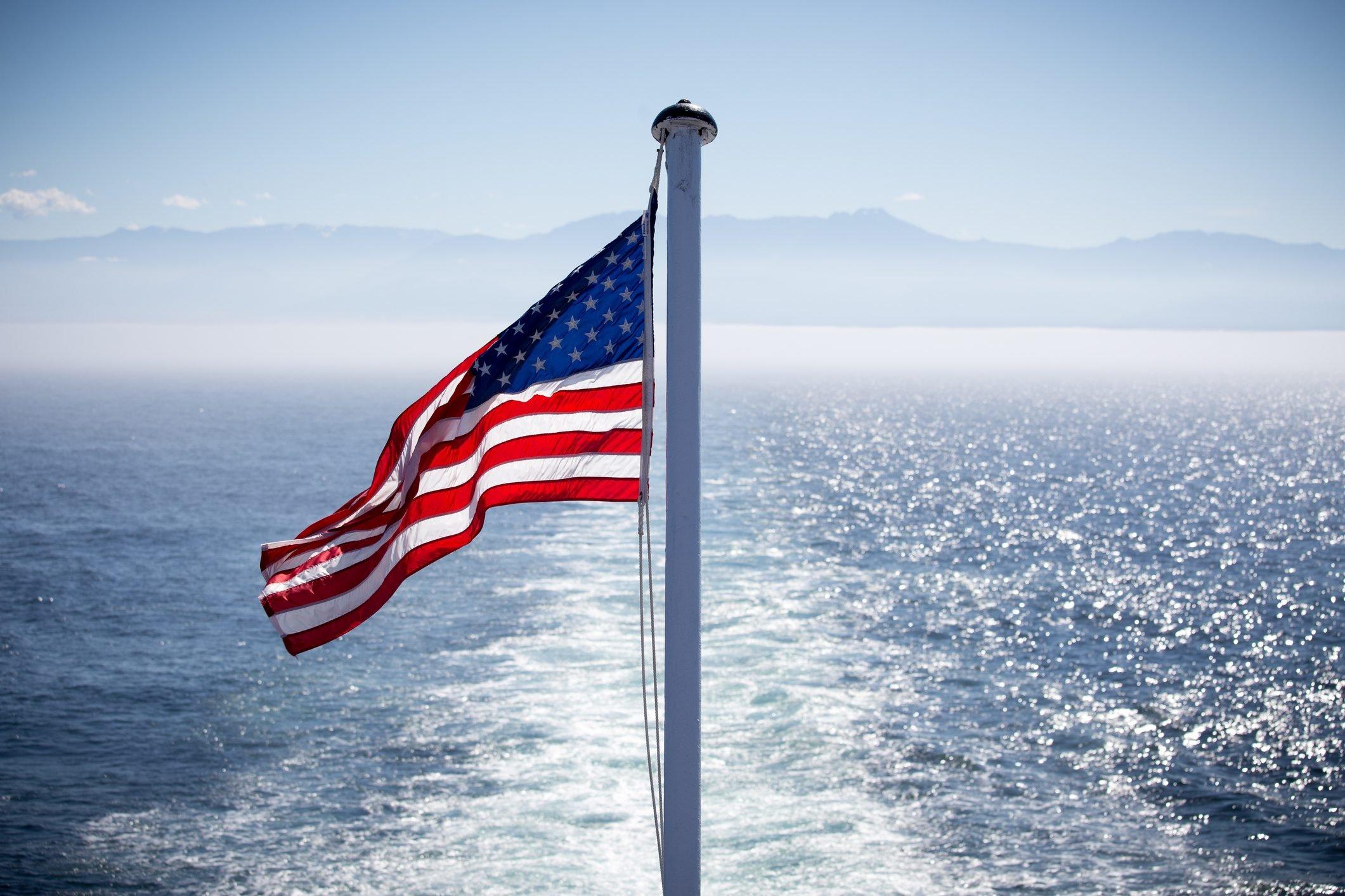 an American flag and sea, Port Angeles, Washington, USA