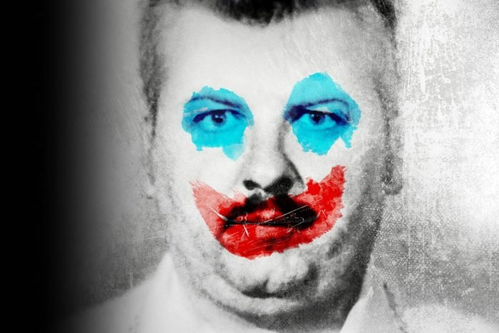 black and white face of man with clown make up in color overlay