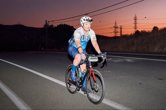 Mike Cohen riding his bike at dusk