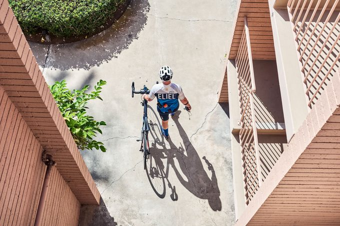 Mike Cohen walking with his bike; from above