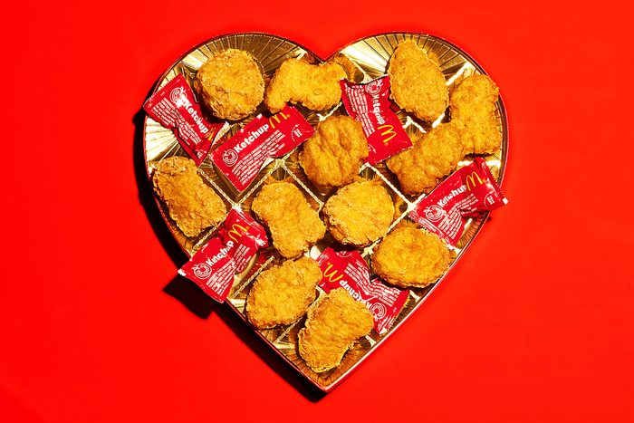 valentine candy box with mcdonalds chicken nuggets and ketchup packets where the chocolate would be